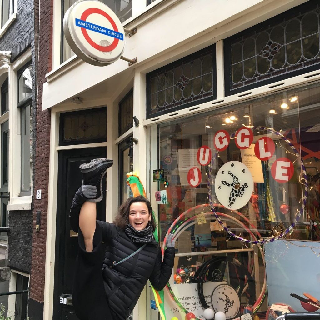 flexible high kicking in front of a circus shop in Amsterdam