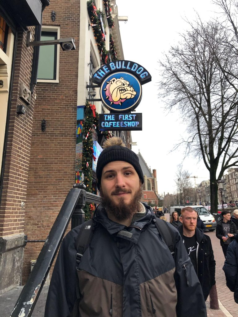 Man standing outside the Bulldog cafe Amsterdam