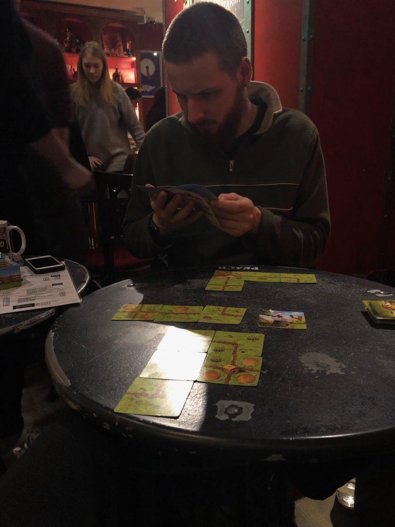 boy playing a board game Paris