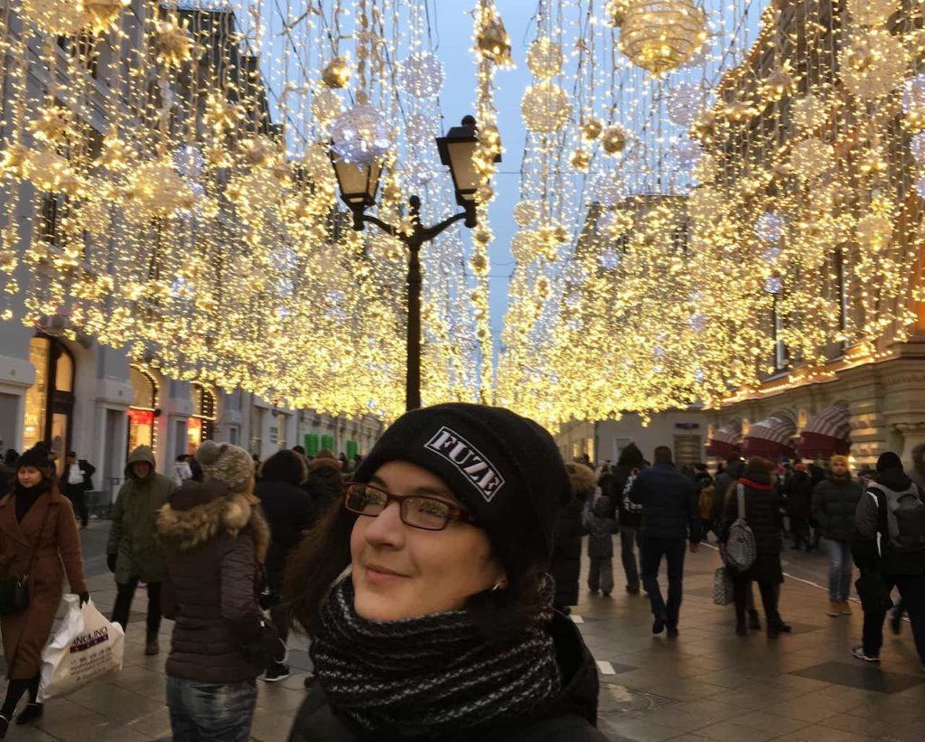 girl surrounded by fairy lights moscow