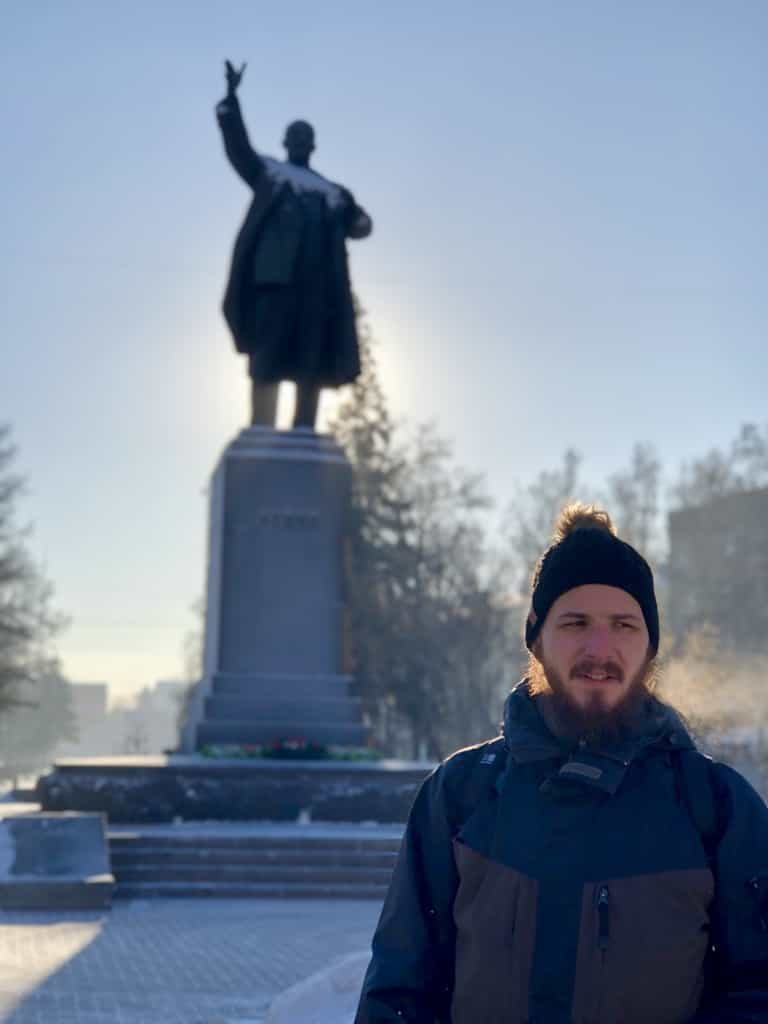 Man standing in front of Lenin Monument Ulitsa Lenina, Irkutsk in the sunshine