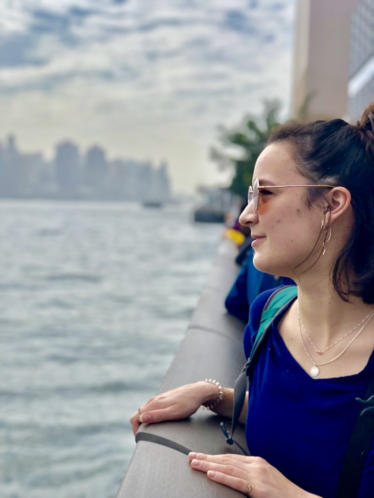 girl wearing sunglasses, standing on victoria harbour with central Hong Kong skyline in the background. 4 Days in Hong Kong: Markets and Monasteries  www.thedancingcircustraveller.com