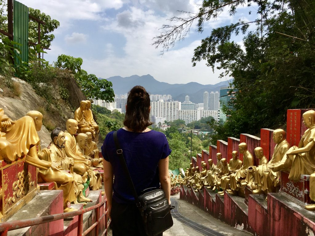 girl overlooking the golden buddhas statues at 10,000 buddhas monastery hong kong. 4 Days in Hong Kong: Markets and Monasteries  www.thedancingcircustraveller.com