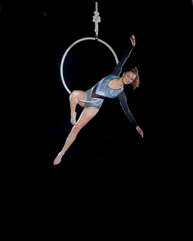 Dancing Circus Traveller posing on an aerial hoop